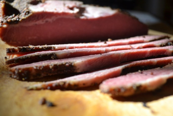 Thick slices of homemade pastrami. Full recipe on BigTasteTinySpace.com