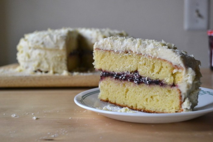 Lemon cake stuffed with bluberry jam and slathered with vanilla buttercream. Full recipe on BigTasteTinySpace.com