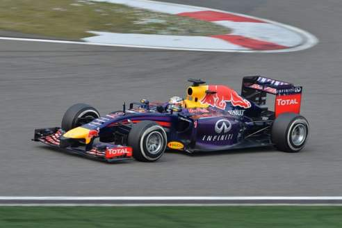 Formula one car:  Sebastian Vettel driving  Red Bull car
