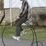 22160450-BicycleManOnHiWheel