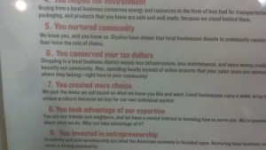Close-up of signage about the value of shopping locally.  5) You nurtured community. 6) You conserved your tax dollars. 7) You created more choice. 8) You took advantage of our expertise.
