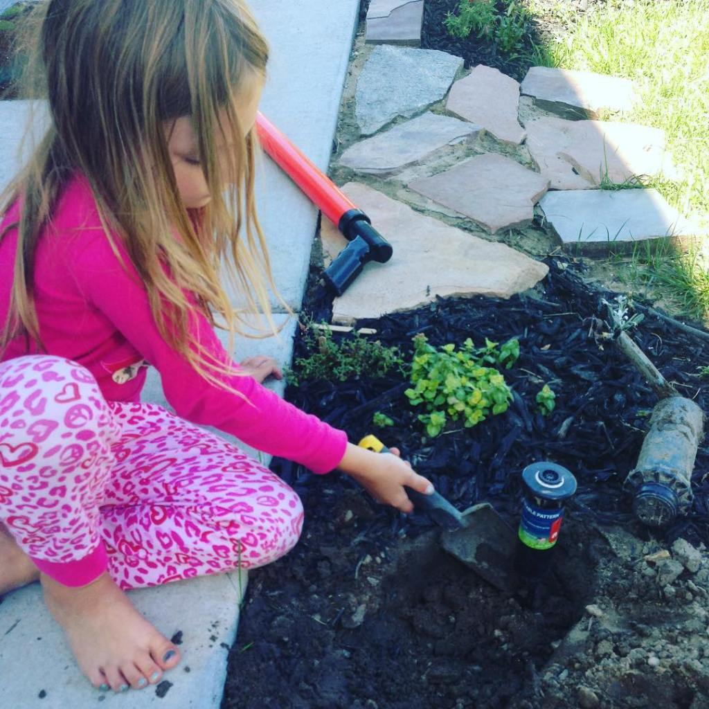Never too young to learn sprinkler repair gardening landscaping summatime
