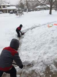Bruce & Sal shoveling their mom out while dad is out plowing
