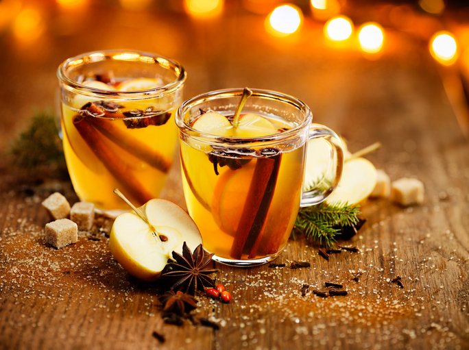 Hot cider with addition of cinnamon sticks, anise stars, cloves and citrus fruits