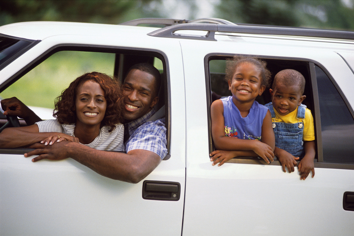 African American family in car road trip