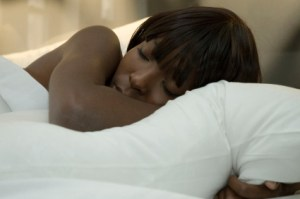 black woman sleeping on pillow