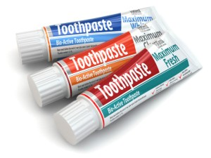 Three packages of toothpaste