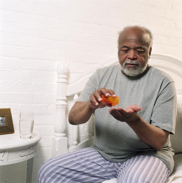 man with medicine bottle