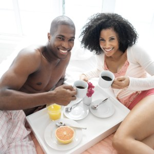 couple coffee breakfast in bed