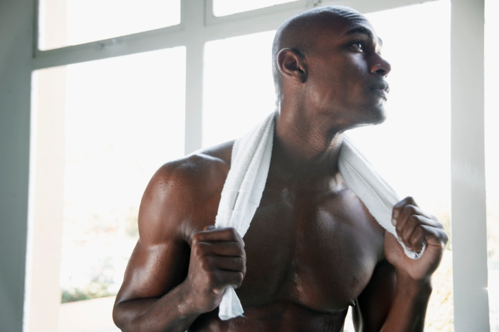 man with towel on, chest out