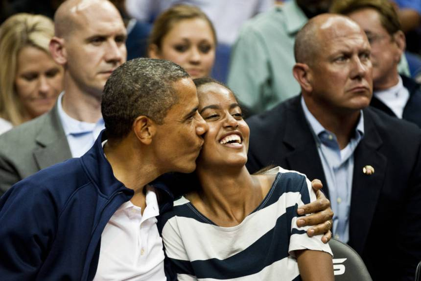 Michelle, Barack, and Malia Obama take in an exhibition game between the United States national basketball team and the Brazilian national basketball team at Verizon Center, Washington D.C., Monday, July 16, 2012. (Ryan M.L. Young/The Washington Times)