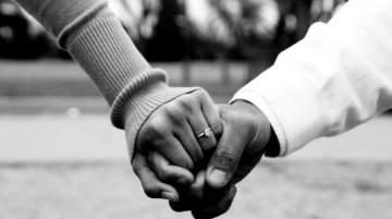 Black Couple Holding Hands
