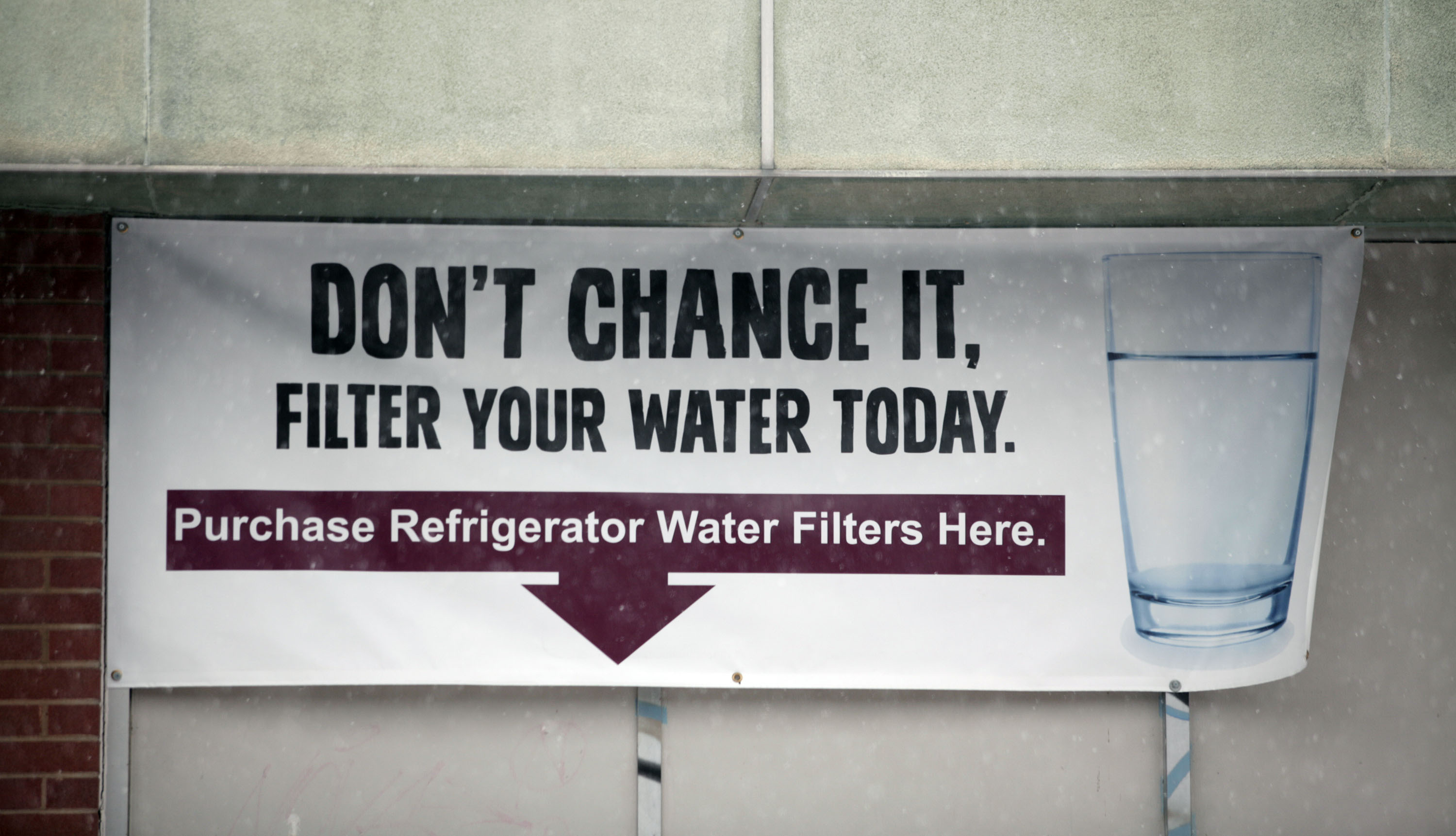 FLINT, MI - JANUARY 17:  A sign on a the front of a building warns residents to filter their water January 17, 2016 in Flint, Michigan. U.S. President Barack Obama declared a federal emergency in Michigan, which will free up federal aid to help the city of Flint with lead contaminated drinking water. Michigan Gov. Rick Snyder requested emergency and disaster declarations after activating the National Guard to help the American Red Cross distribute water to residents.
