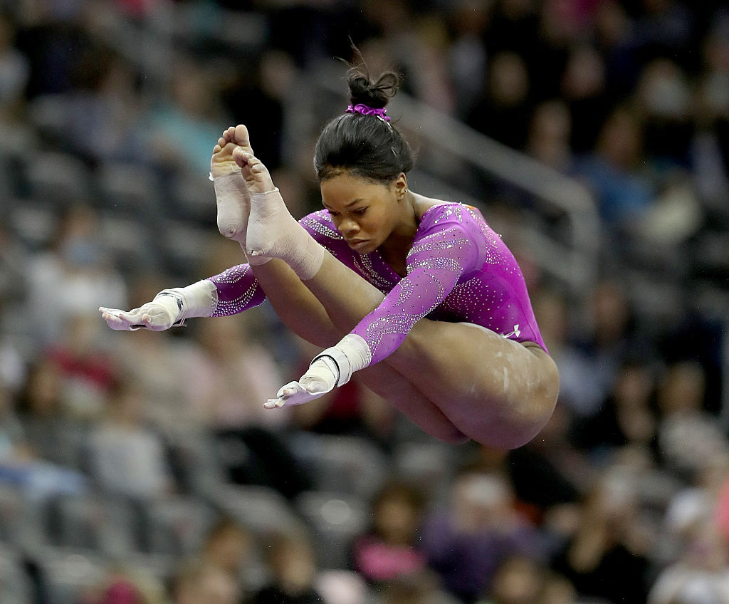 NEWARK, NJ - MARCH 05:  Gabrielle Douglas of the United States competes on the uneven parallel bars during the 2016 AT&T American Cup on March 5, 2016 at Prudential Center in Newark, New Jersey.