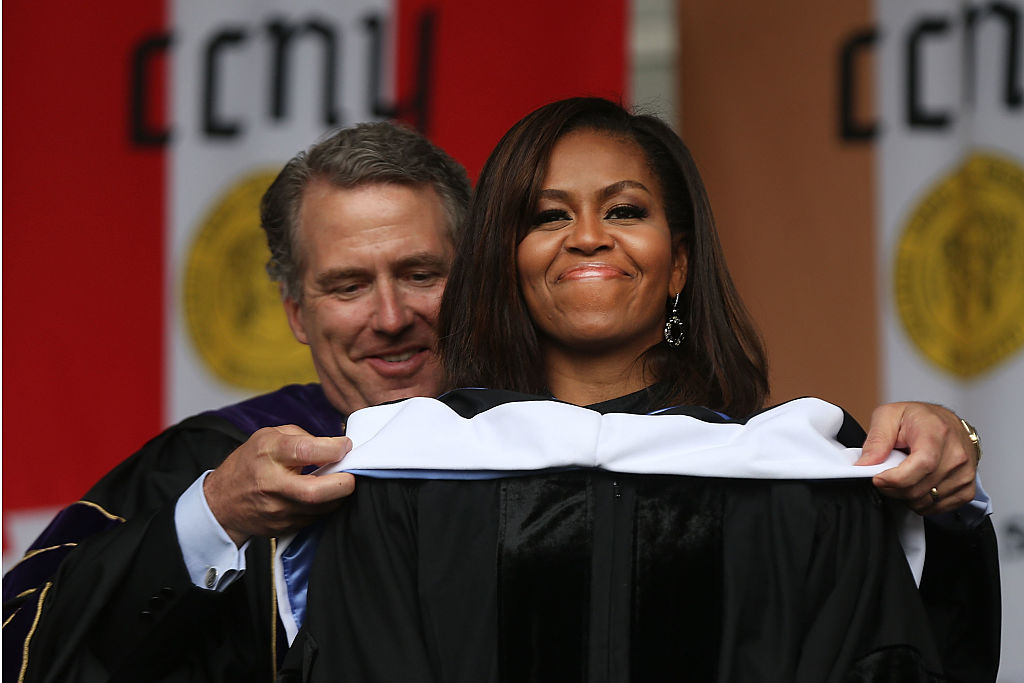 NEW YORK, NY - JUNE 03:  First lady Michelle Obama is presented with an honorary doctorate of humane letters by James Milliken, the chancellor for the City University of New York , while delivering the commencement speech at City College on June 3, 2016 in New York City. This is the final  commencement speech of her tenure as first lady. In her speech Mrs. Obama celebrated City College's diverse student body and the struggles that many students endured on the road to graduation.