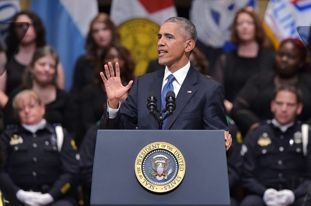US President Barack Obama speaks during an interfaith memorial service for the victims of the Dallas police shooting at the Morton H. Meyerson Symphony Center on July 12, 2016 in Dallas, Texas. President Barack Obama attended a somber memorial Tuesday to five police officers slain in a sniper ambush in Dallas, as he seeks to unify a country divided by race and politics. / AFP PHOTO