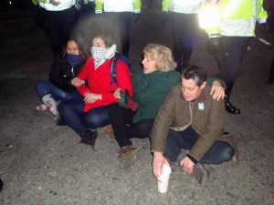 Just when it seemed no more arrests would be made, these four women bolted into the middle of the intersection of Summer Street and Atlantic Ave and sat down until police took them away as well. (Blast Staff photo/John Stephen Dwyer)