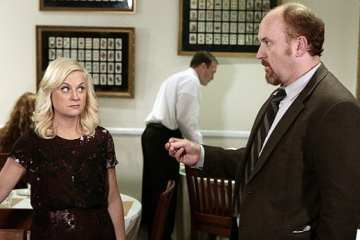 Louis C.K reprises his role as Leslie's cop ex-boyfriend Dave Sanderson (right)