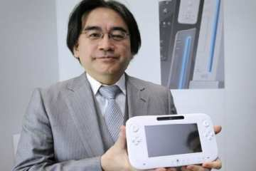 Nintendo's President Satoru Iwata displays the Wii U during E3, the Electronic Entertainment Expo, in Los Angeles