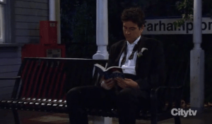 Ted waits at the Farhampton train station after leaving Barney and Robin's wedding.