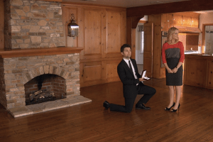 Ben (Adam Scott) proposes to Leslie (Amy Poehler) in their new home.