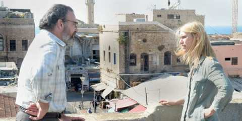 Carrie Mathison (Claire Danes) flees to the rooftop in panic and Saul consoles her.