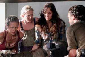 "The group deals with the discovery of the live prisoners and Hershel's injury in ""Sick"""