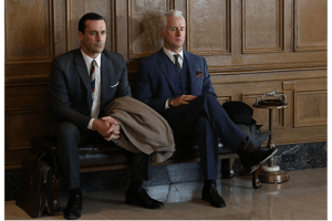 Don (Jon Hamm) and Roger (John Slattery) wait patiently to pitch for Chevy, a career-defining account.
