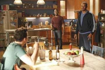 Coach (Damon Wayans Jr) tries to get Nick (Jake Johnson) to exercise.