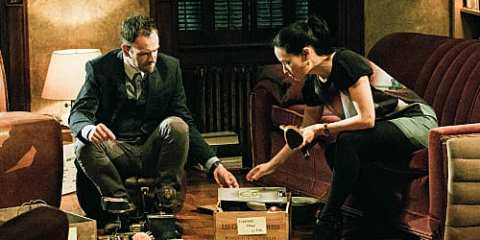 Sherlock (Jonny Lee Miller) and Joan (Lucy Liu) search for clues on their newest case.