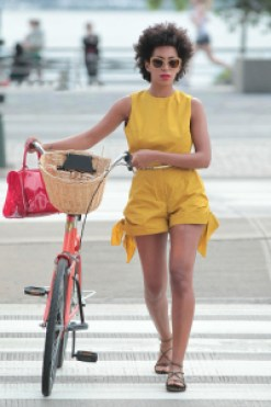 Solange on Mother's Day bike ride wearing yellow jumper