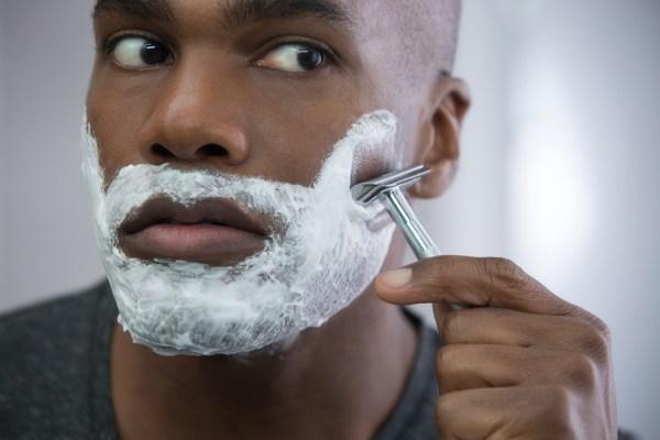 black man shaving