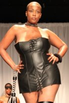 Tracie Collins rocking a leather bustier for the finale of Kiss the Curves