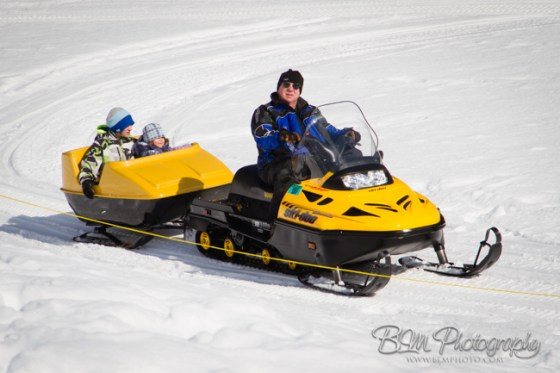 John Beckta Giving a Snowmobile Ride