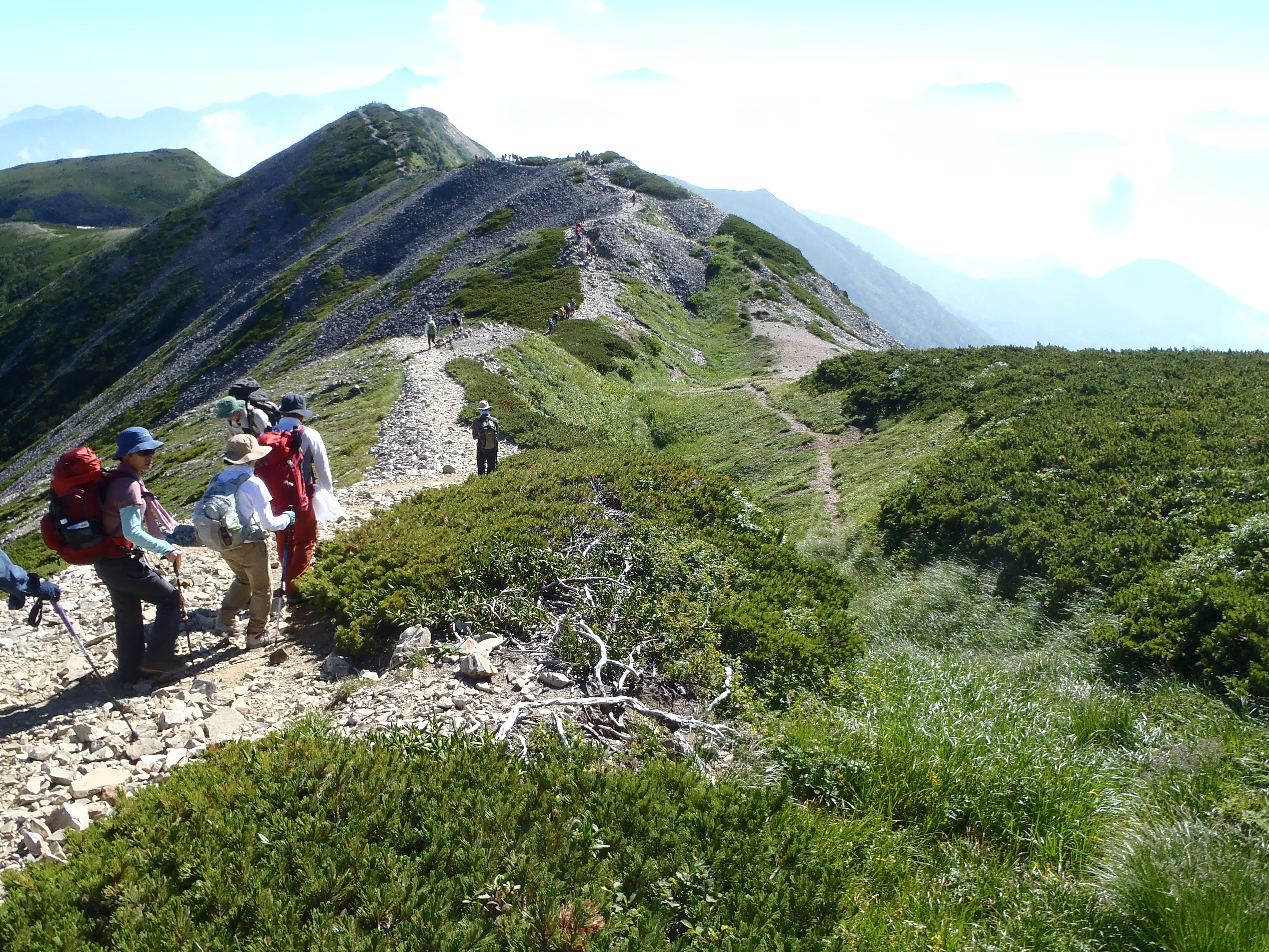 Climbers hike along the ridge of Mt. Korenge
