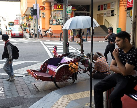 Pensively waiting for the bus at KOMTAR
