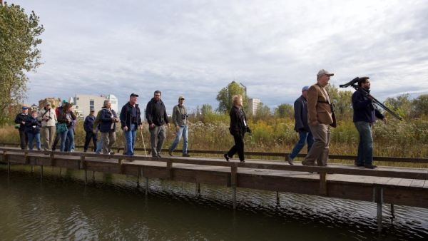 ABA Staffer George Armistead leads a group on the grounds of the Grange Insurance Audubon Center, photo by Greg Niese
