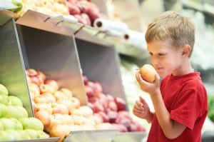 http://www.dreamstime.com/royalty-free-stock-photography-little-boy-choosing-bio-apple-food-fruit-vegetable-shopping-store-image29720357