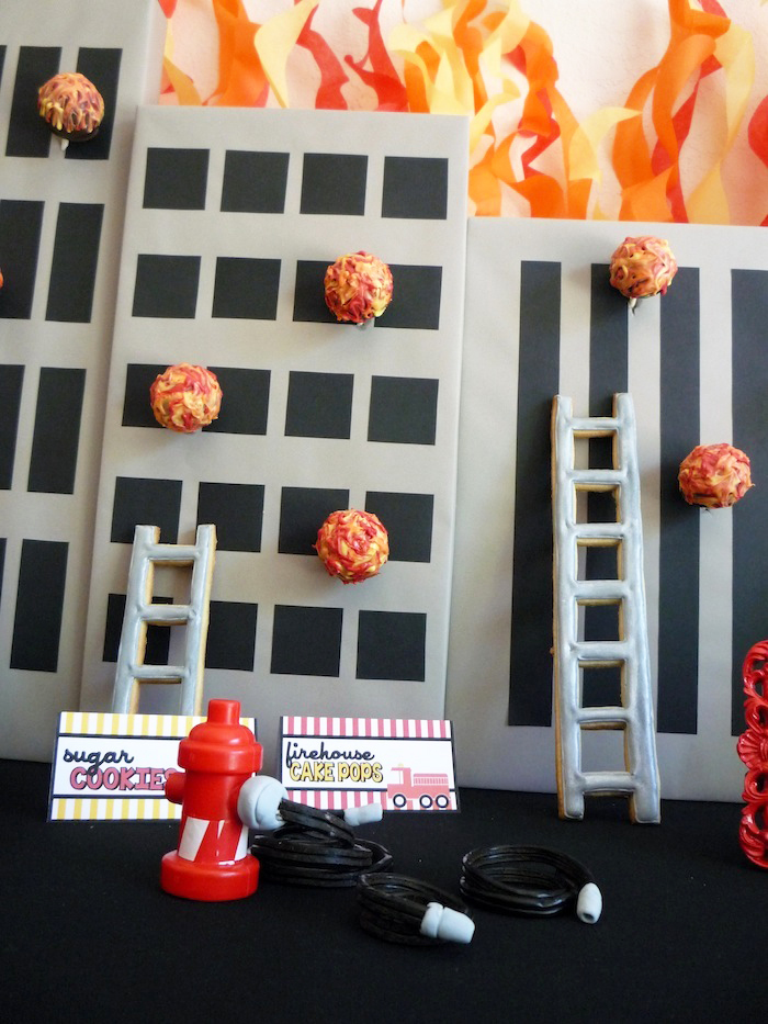 Fireman Cake Pops1 Five Alarm Guest Dessert Feature {& Tissue Fire Backdrop Tutorial}