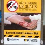 Quatis warning sign