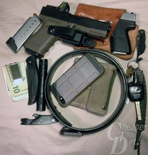 Picture shows someone's EDC including a GLOCK 19 and Kahr Arms 9mm.