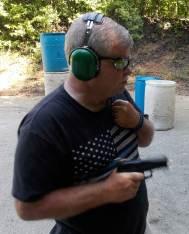 Bob Campbell shooting handgun one handed