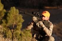 HUnter shooting at an upward angle