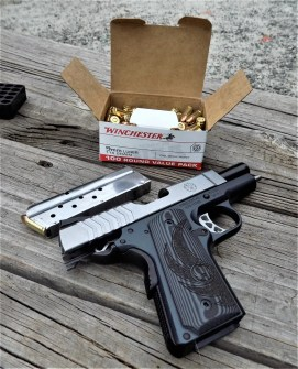 Ruger 1911 pistol with the a box of Winchester USA ammunition