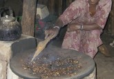 An Ethiopian woman roasts coffee with her new cooking stove. Photo courtesy Daniela Tunger