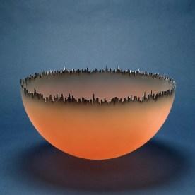 Cityscape, Jay Musler, 1981. Blown, cut, sandblasting, airbrushing. H: 23.2 cm, Diam (max): 45.6 cm. (82.4.8)