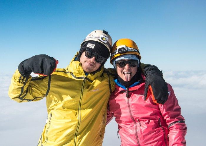 luaren steele and zach doleac climbing a mountain