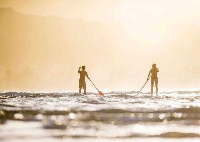 couple paddleboarding inflatable paddleboards