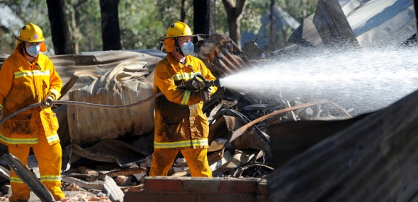 What's left of homes after bushfires swept through Warrandyte, in Victoria, in January. Image: AAP Image/Joe Castro