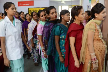 Pregnant Indian women wait for a check-up at a government hospital in Amritsar on July 11, 2013, on the occasion of World Population Day. Africa and Asia are the continents that will see the fastest urban population growth in the next 40 years, a UN report said earlier in the year noting that India and China are leading the surge. The Earth's population is expected to roughly triple by 2050 compared to a century earlier. It stood at three billion in 1950, reached seven billion in 2011 and is likely to reach about 9.5 billion by 2050 -- a rise that will occur especially in the poorest countries, according to UN estimates. AFP PHOTO/NARINDER NANU        (Photo credit should read NARINDER NANU/AFP/Getty Images)